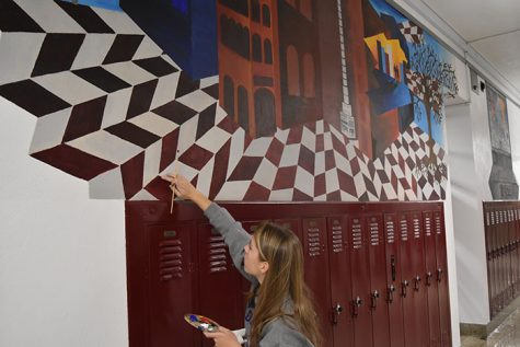 Artists work on touching up old murals (photo gallery)