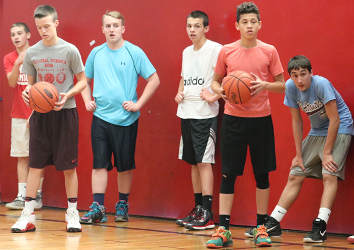 Learning a drill, freshman boys basketball players concentrate during tryouts. The boys were told whether or not they made the team November 22. One of our main goals this year is to just get better every day that play and practice, freshman Peter Zwiebel said.