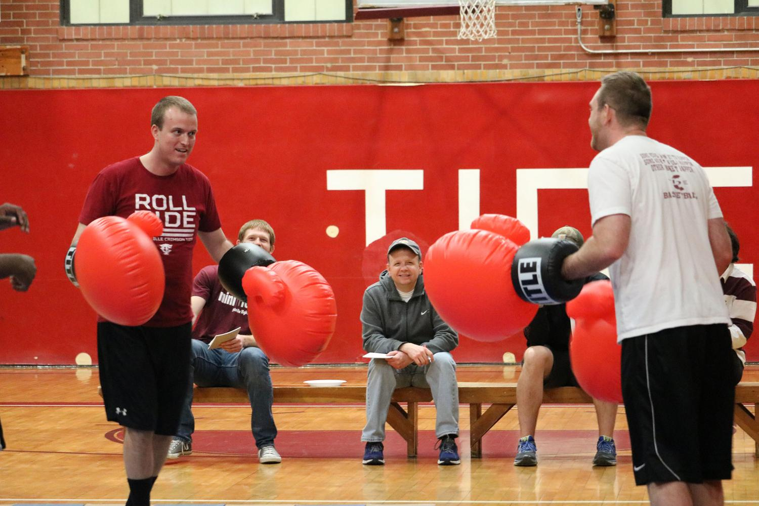 FIGHT- Mr. Nathan Halenar and Mr. Cody Blankenhorn help fight against childhood cancer by having a boxing match as part of the Mini-THON fundraiser. Students cheered on their favorite teacher. At the end of the fight, Mr. Blankenhorn won.