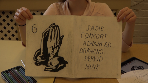 Sadie Comfort shows off her Visual journal