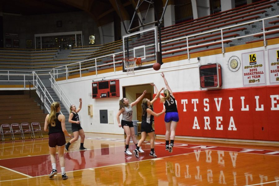 Senior Lexi Plachko goes up for a layup during a girls basketball practice. The team usually practices after school in Martz Hall or the high school.