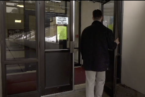 New security measures at school require visitors to drop items off on a desk instead of entering the building.