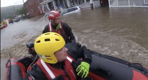"Mr. Schuttler, the middle school's librarian, is a volunteer firefighter. He said, ""We got called down to the station. We were going around … house to house trying to get to people who had been affected by the flood, out of the flood. Once the water receded, then we switched to pumping  out basements. We pretty much just set up teams going house to house trying to get to get the water out of their basements, and we did that for the rest of the week. It was a flash flood, so the water came up, flooded, and then dropped again. So once everyone was safe, we had to switch to getting them back to together again. We had to set up a shelter. Some people were in the shelter for a few hours. They assembled a food pantry in town for the people who lost most everything in the flood. Once the basements were done, it switched to some workers coming in and cleaning up all the debris."""