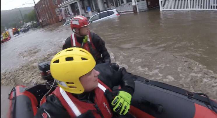 """Mr. Schuttler, the middle school's librarian, is a volunteer firefighter. He said, """"We got called down to the station. We were going around … house to house trying to get to people who had been affected by the flood, out of the flood. Once the water receded, then we switched to pumping  out basements. We pretty much just set up teams going house to house trying to get to get the water out of their basements, and we did that for the rest of the week. It was a flash flood, so the water came up, flooded, and then dropped again. So once everyone was safe, we had to switch to getting them back to together again. We had to set up a shelter. Some people were in the shelter for a few hours. They assembled a food pantry in town for the people who lost most everything in the flood. Once the basements were done, it switched to some workers coming in and cleaning up all the debris."""""""