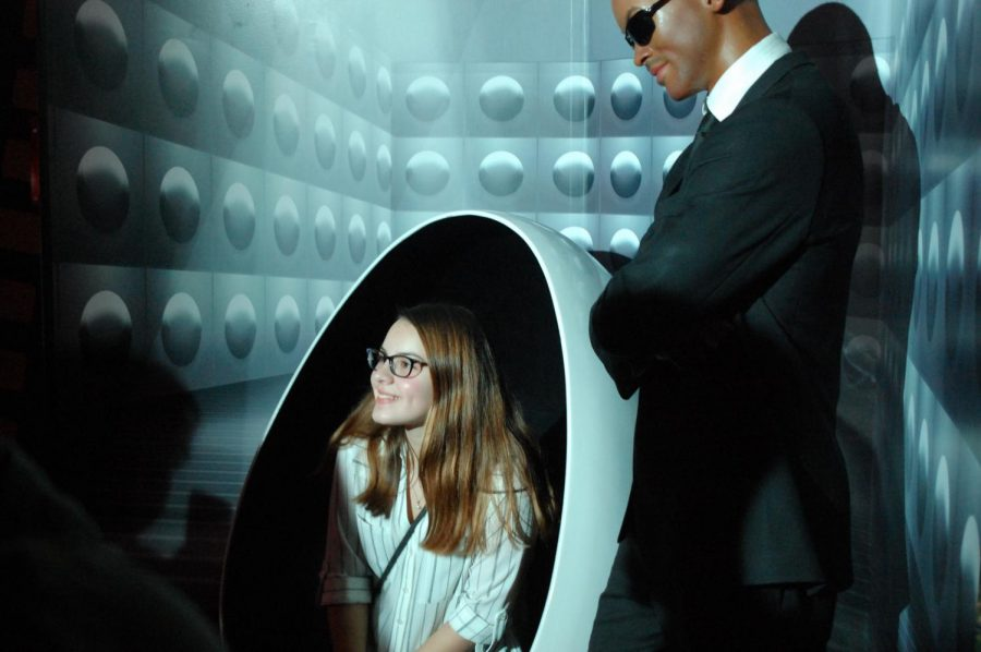Freshman Ruby Shipe poses for a picture with the wax figure of Will Smith in the movie Men In Black at Madame Tussauds Wax Museum.