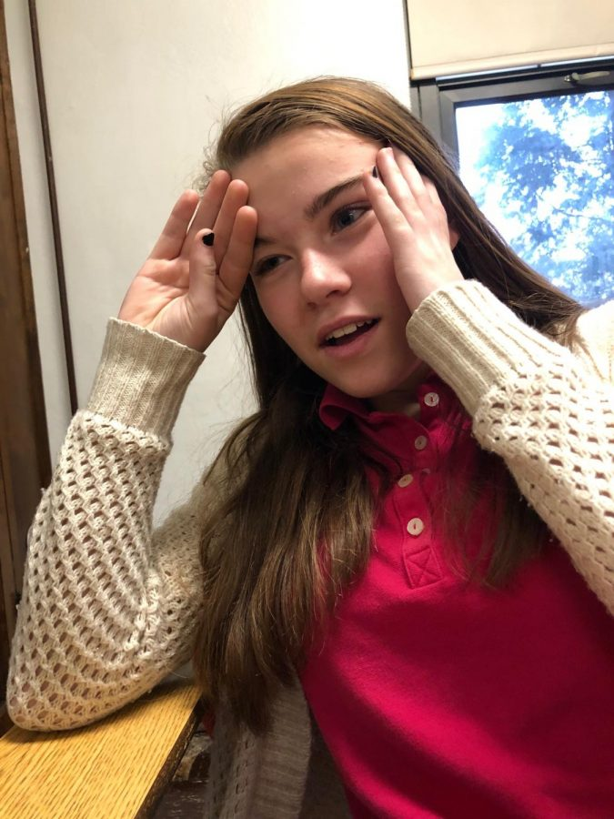 """Sophomore Christina Huff is sweating in Mr. Shott's classroom. The heating system has not been properly functioning the past couple weeks. """"I like classrooms when they are cooler."""""""