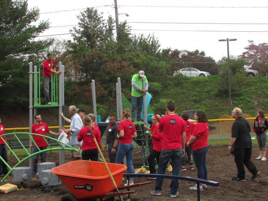 Volunteers from Pottsville Area School District and Wells Fargo work together to build a new playground for John S. Clarke Elementary Center's bus circle. This was part of the