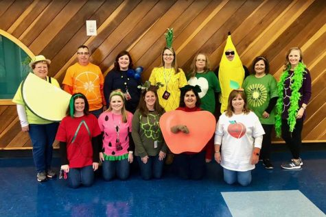 """John S. Clarke teachers dressed as a fruit salad pose for a picture. Teachers and students at the elementary center held their annual Halloween parade on Friday, October 26. """"The parade gives all the children something to participate in instead of doing math and reading. The parade lets the community be a part of it. The parents get to watch,"""" Mrs. Debbie Lecker said."""