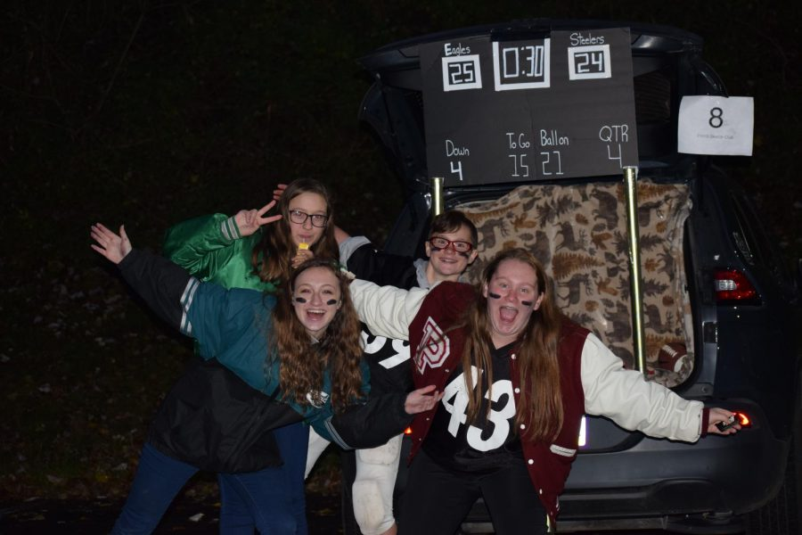 """Freshman Aiyana Brode (top right) poses with family and friends. She said, """"We chose it [the theme] because we both like football and we ended up with the Eagles and the Steelers because those are our families' favorite teams."""""""