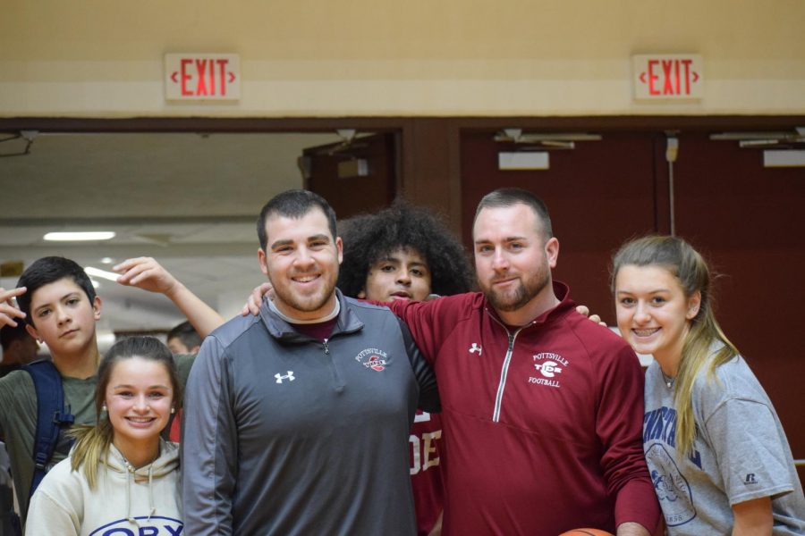 """Health and physical education teacher Mr. Jake Wartella (middle right) poses with students and staff after the gym activity. """"It's just great seeing all the kids having fun, being interactive, and showing great school spirit,"""" Mr. Wartella said."""
