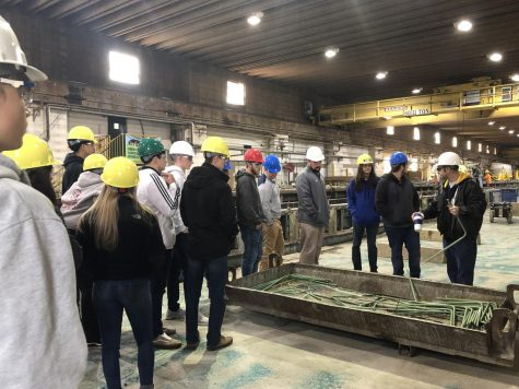 """The engineer shows rods that go inside the beams to make them sturdy. """"The trip was eye-opening. I got to see the in-depth plans on the computer. The pieces are so much more than concrete and rebar. It was nice to see what goes into our local bridges,"""" said senior Josh Collucci."""