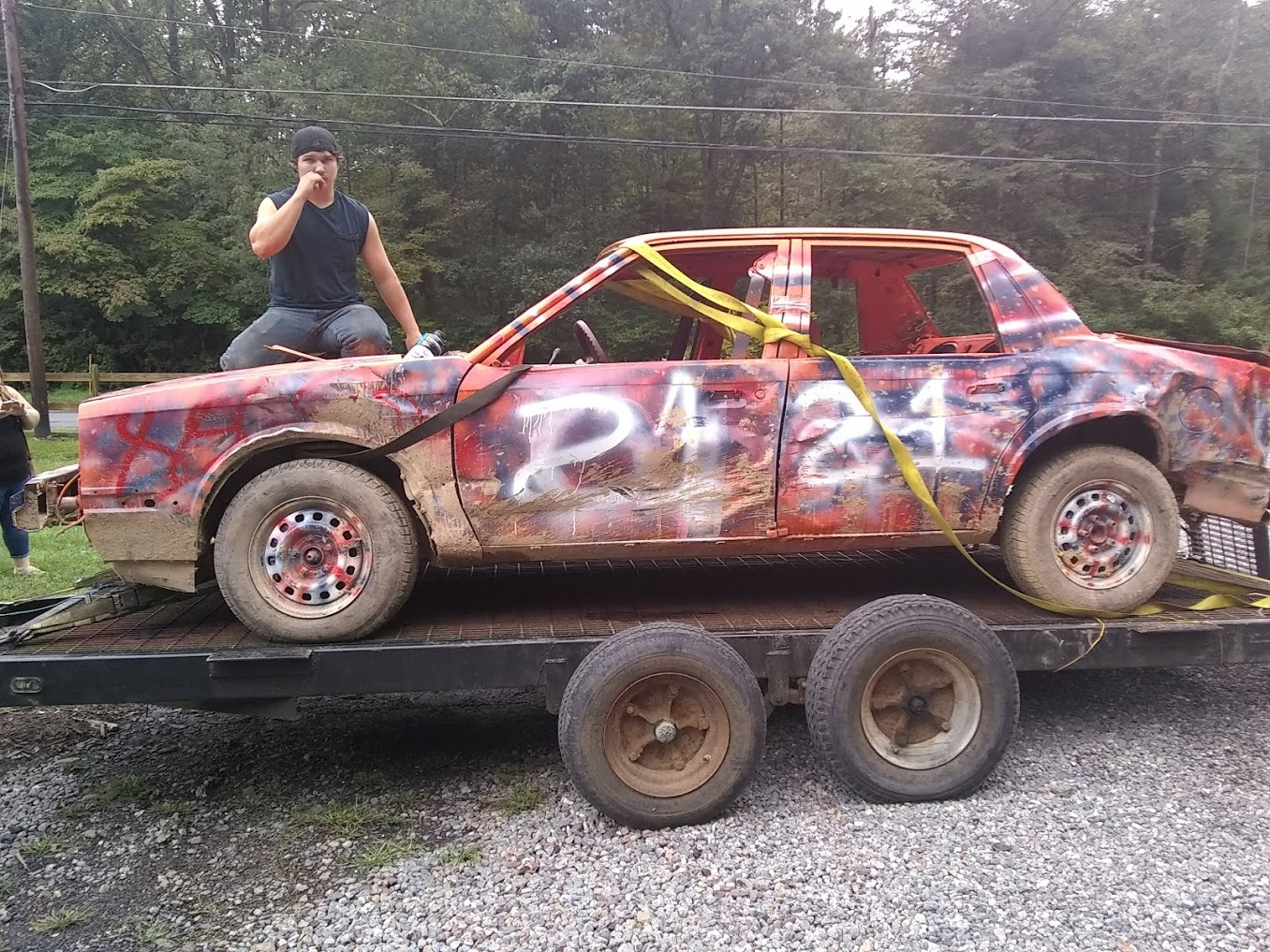 Senior Noah Brittenburg poses with his demolition racing car.