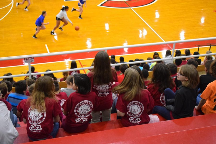 "Middle schoolers from D.H.H.Lengel and Saint Clair sit in the bleachers watching their peers play basketball. They enjoyed playing basketball, watching basketball, and swimming.  ""I'm having a good time watching the game with my friends,"