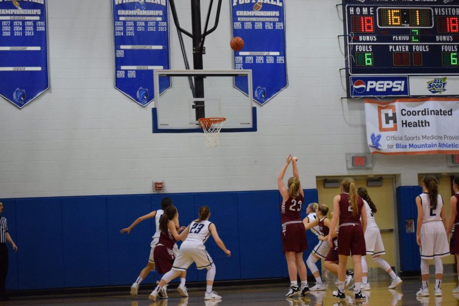 "Junior Kalie Conrad shoots a free throw while other Tide players surround her. The Eagles waited anxiously as she shot the ball. ""Our last game went very well because Pottsville was able to walk off the court with a win,"" said Senior Alexa Cesari."