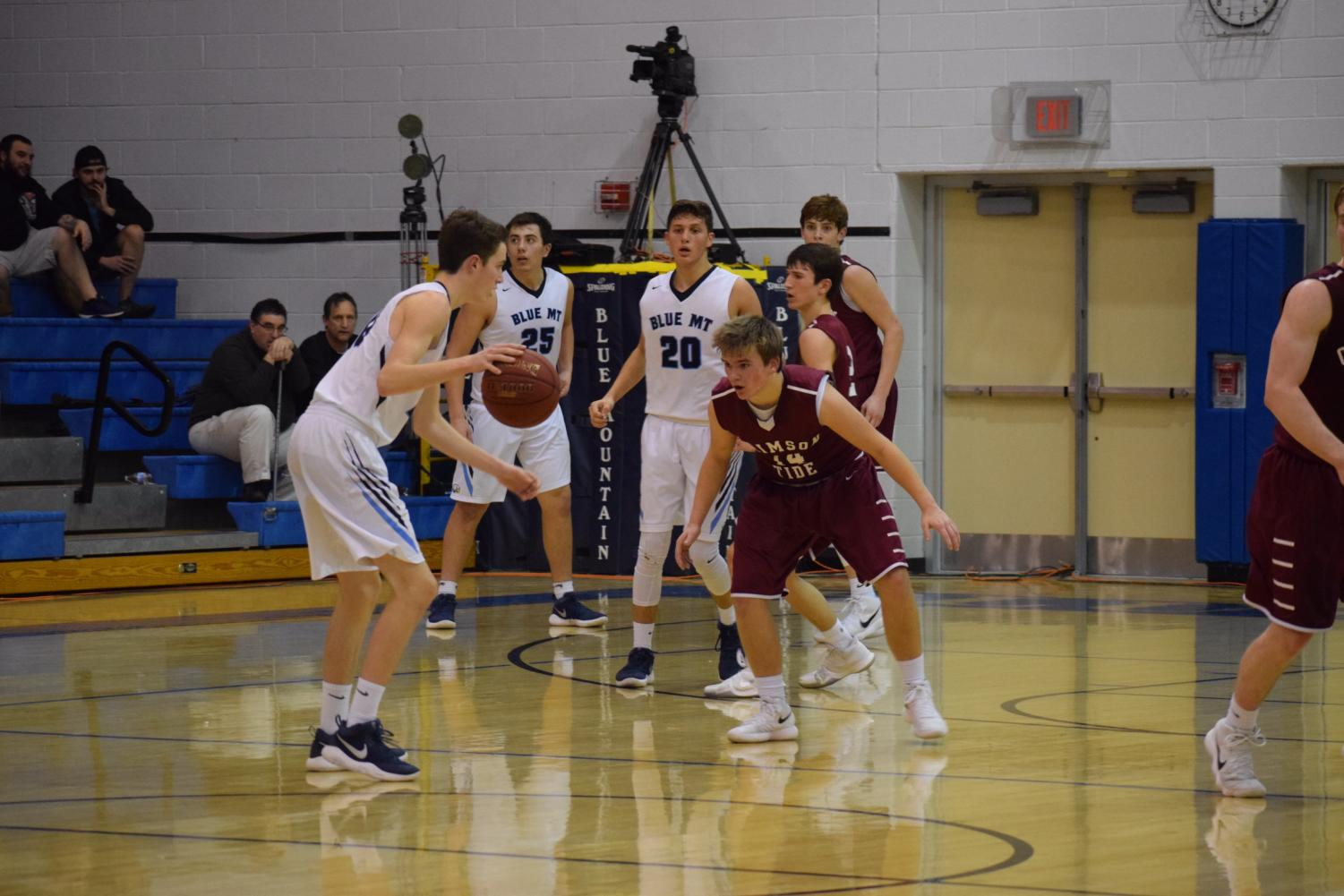 "Aiden Stanton stands in front of Blue Mountain player trying to block the ball. He moved quickly to stop him from getting the shot. ""My brother and I are a lot harder on each other than our other teammates."""