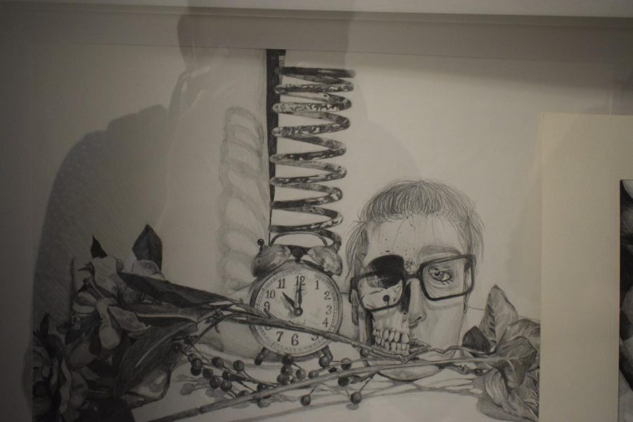 Junior Caitlyn Kline's project for Honors Advanced Drawing will be featured in the art show.