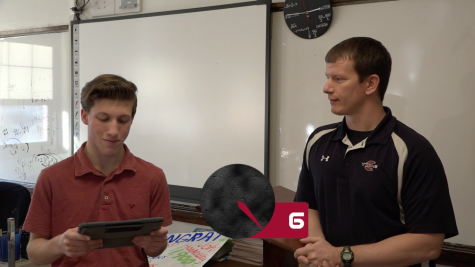 Mr. Rhoades answers quick questions in a game of 60 Seconds.