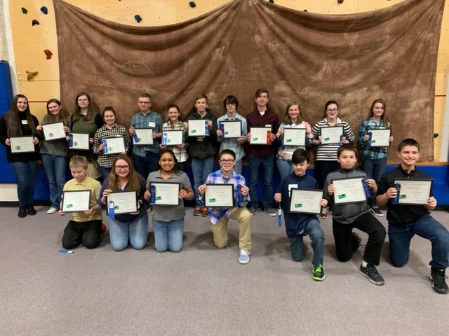 "Thrilled Eighth graders stand with their certificates. After the STEM competition, the awards ceremony took place afterwards. ""It is amazing to see the final project and what goes into manufacturing,"" Dominic Stelie said."