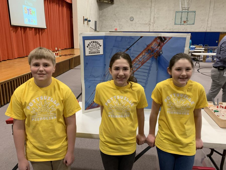 Fifth graders Emmett Kraft, Caroline Hobbs, Maggie Brennan pose for a picture before the start of the competition.