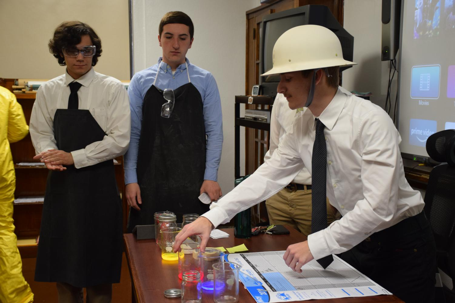 Junior Kenneth Glore can be seen demonstrating his part of the presentation. He was describing the uses for radioactive material during the Manhattan Project.