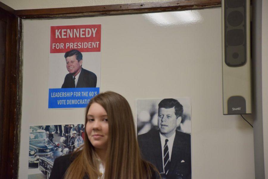 Junior Alyssa DeLeon eagerly awaits giving her part of the presentation on John F. Kennedy.