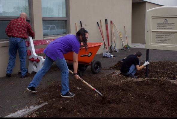 "Sophomore Victoria Lutz moves mulch to a planter bed at John S. Clarke elementary center on September 16, 2019. Lutz, a student in the PAHS Life Skills class, had the opportunity to learn landscaping skills with her peers while helping beautify the school grounds. ""I loved learning how to landscape because it's different from everyday school activities."""