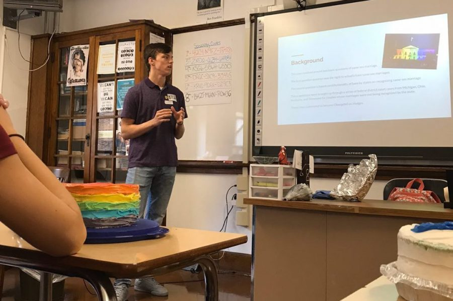 "Senior Adam Kelly is presenting his Supreme Court case on Cake Day. Kelly enjoyed trying all the different cakes. ""I absolutely loved Cake Day. It was a great way to incorporate a fun activity into the lesson."""