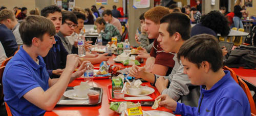"Featured students enjoy their Thanksgiving meal provided by the PAHS lunch staff. This lunch excited some students for the upcoming holiday. Sophomore Evan Woodward said, ""I appreciate how the school adds variations to the lunches such as the Thanksgiving preview."""