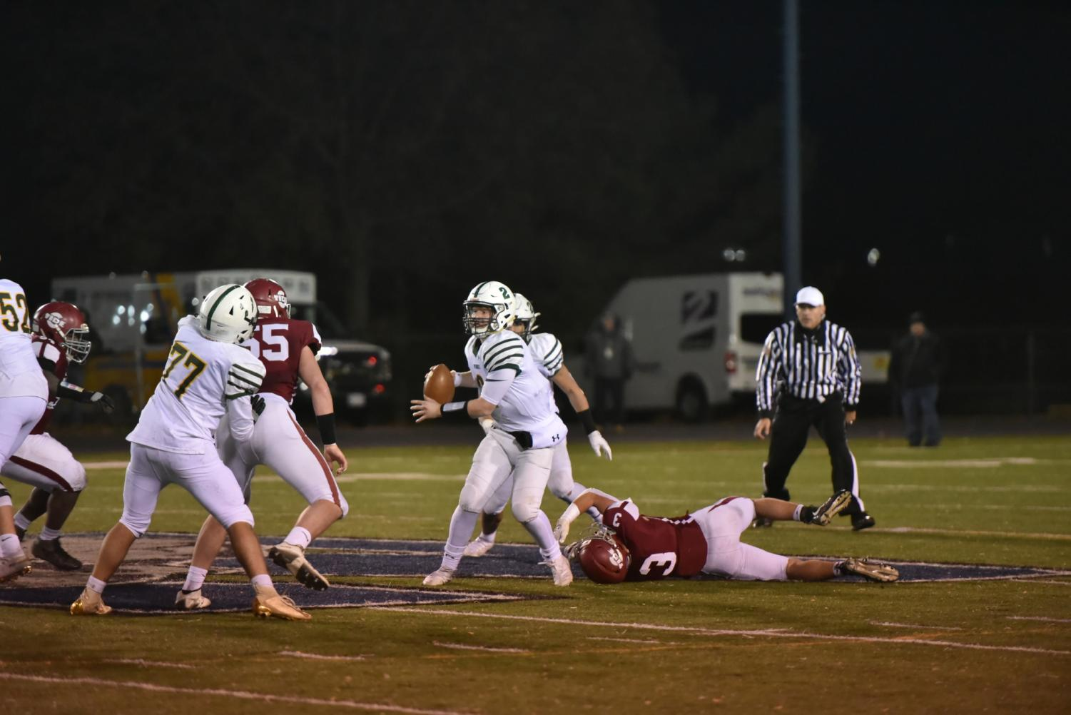 """Junior Robert Walchak dives in an attempt to tackle the ACC quarterback. Walchak played football since he was young and has dreamed about winning the District Championship. """"We deserved that win so much more than any other team in the district,"""" said Walchak."""