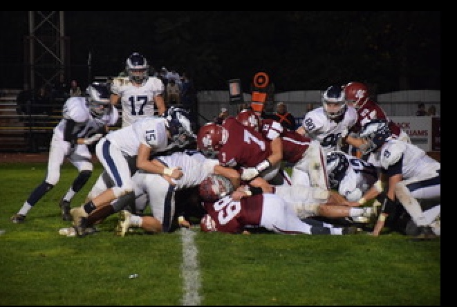 "Crimson Tide Quaterback, Damon Yost breaks through the pile of players to score a Tide touchdown against Blue Mountain. Pottsville ended the season with a close game against Jersey Shore, losing 42-35. Damon said, ""I've been playing football for 5 years, and what I love most is the bond you grow with your teammates."""