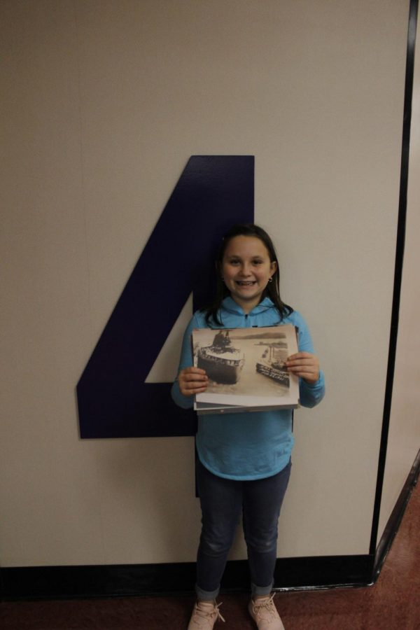 Fourth grader, Hadley Hermany, holds a photo that her great-grandfather took during World War II. He was stationed in Germany during World War II. Hermany said,
