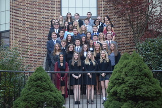 "National Honor Society Inductees stand on the courtyard stairs after their induction. 36 juniors and seniors were admitted into the society that honors academic excellence. Inductee junior Jake Montgomery said, ""Always put your best effort into your work while not overdoing your limits."""