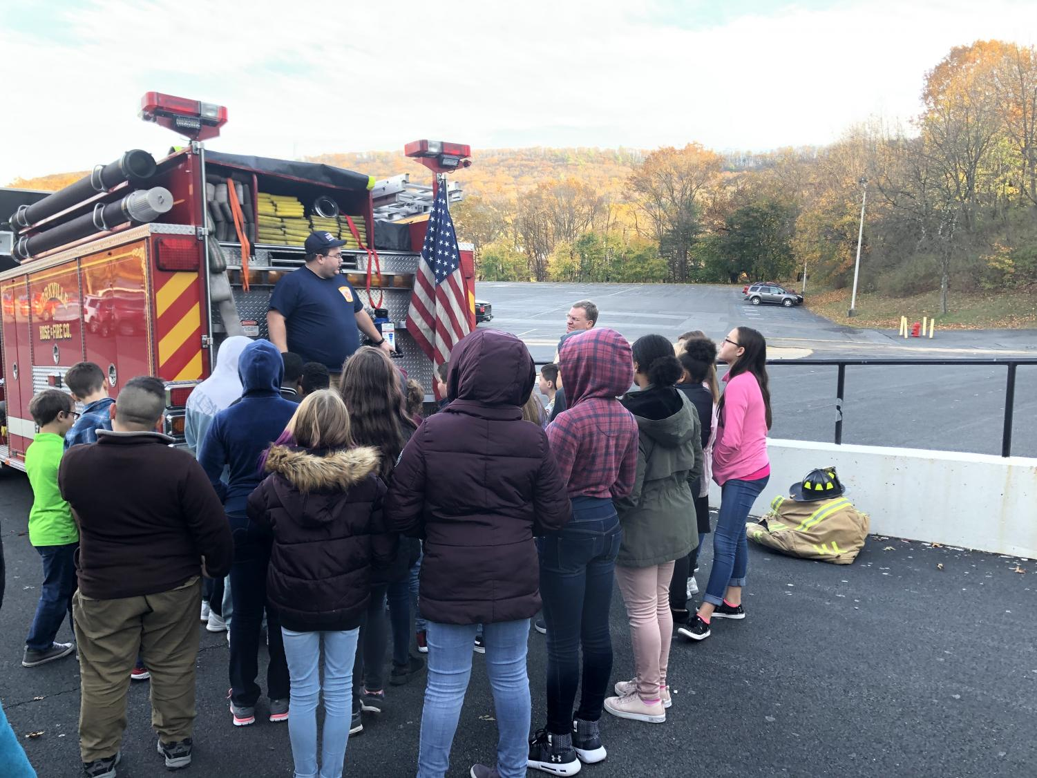 TOUR - Students at the Schuylkill Achieve after school program learn about fire safety and are given a firetruck tour by Lt. Dan Kleeman and Dr. Zwiebel from Yorkville Hose Company.