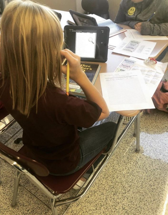 WRITE+-+Sixth+grader+Lexie+Scanlan+uses+her+iPad+to+assist+in+completing+a+text-dependent+analysis+assignment+in+ELA+class.