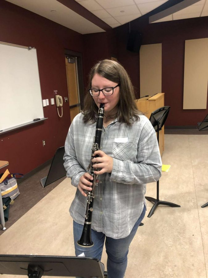 "Junior Grace Mongrain, a clarinetist, is practicing the piece ""Joy Revisited"". ""Joy Revisited"" was one of the two songs that the students played for their concert on November 18. ""It felt pretty fantastic to be able to participate in this event and play with collegiate level musicians. My favorite part of the day was when we got to play in a mass ensemble with the Kutztown Wind Ensemble,"" junior Grace Mongrain said."