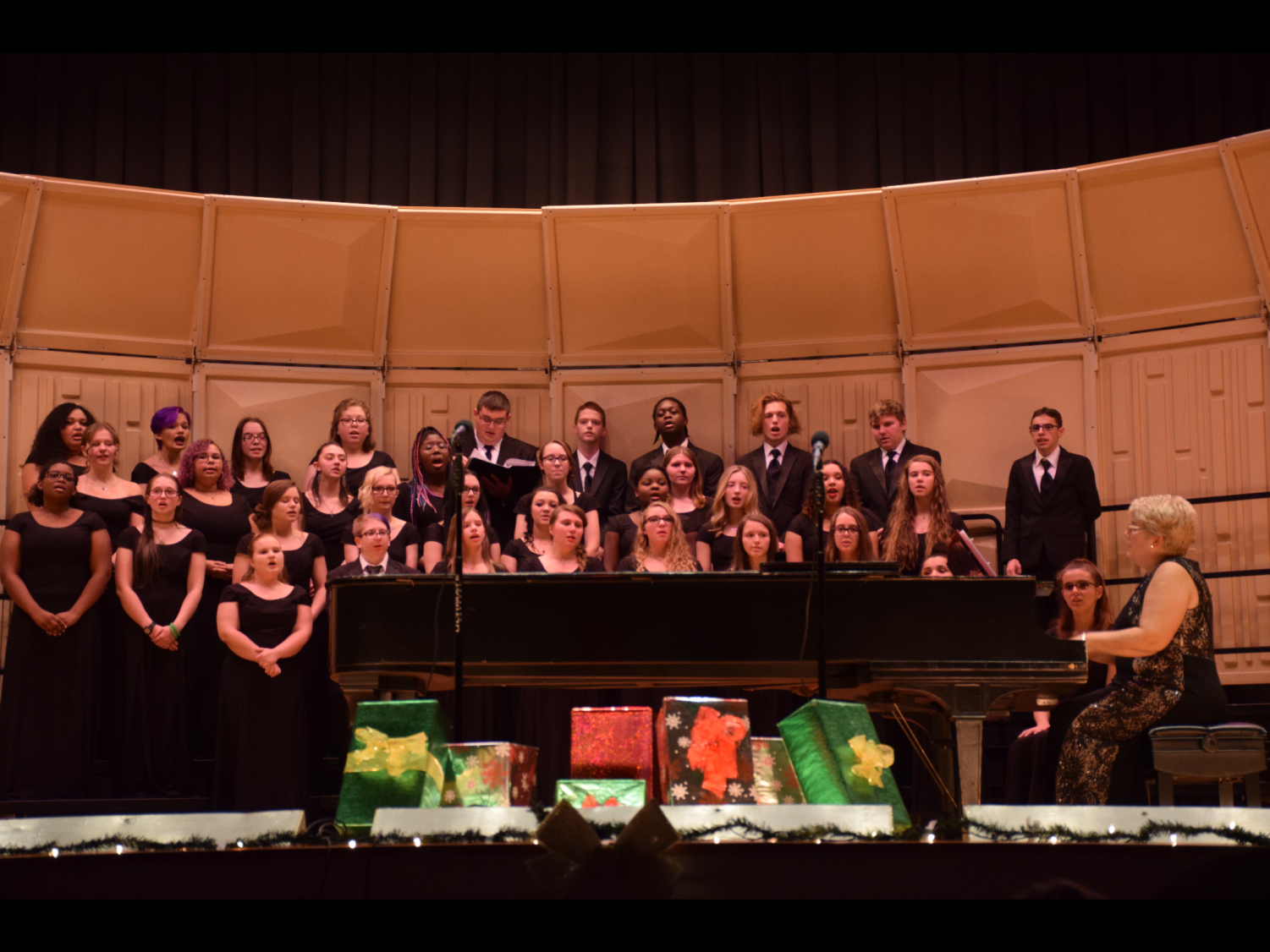 """Members of the PAHS choir sing during their concert on December 12, 2019. They learned challenging songs this year to impress their audience. """"I looked forward to making people happy and proudly singing with the choir,"""" said Junior Christina Huff."""