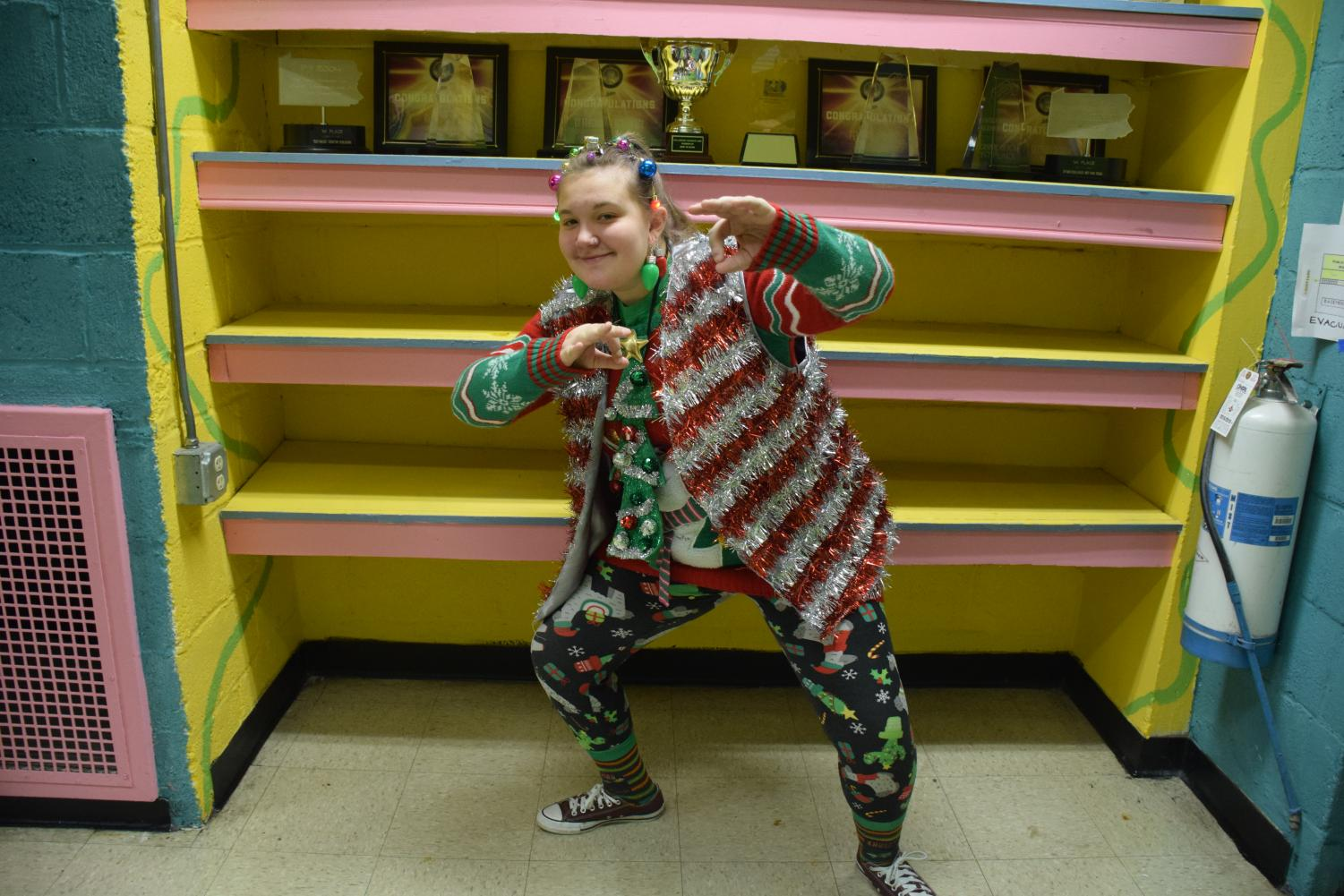 """Junior Laura Hunt shows off her holiday ugly sweater ensemble. Many students who entered the contest coordinated entire outfits to complete their looks. Hunt said, """"I'm a very festive person during the holidays, so I use this as an opportunity to show my spirit!"""""""