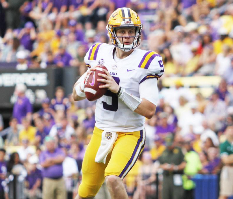 Louisiana State University quarterback Joe Burrow  stands with the ball hoping to make a play. LSU beat the Clemson Tigers with a comeback win of 42-25.
