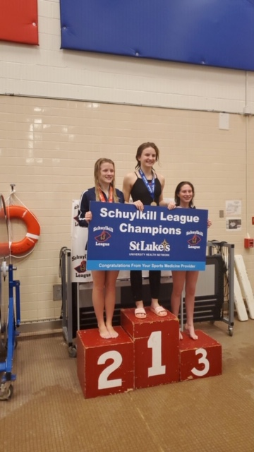 Juniors+Greta+Snukis+and+Emma+Smith+stand+on+the+podium+after+the+Schuylkill+League+Diving+Championships.+Snukis+placed+first+in+diving+while+Smith+placed+third.+Snukis+said%2C+%E2%80%9DMy+hard+work+and+countless+hours+of+nonstop+diving+paid+off.+I+was+super+happy+to+have+clean+dives+throughout+the+meet.%E2%80%9D+