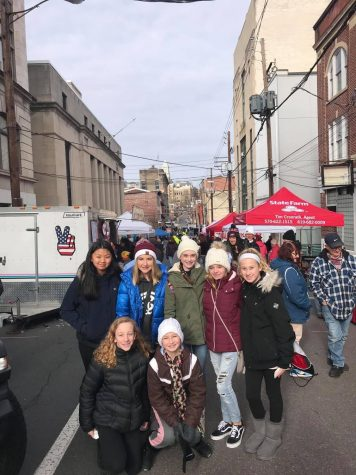 "(Top Row From left to right) Faith Toothacker, Samara Reedy, Brenna McGowan, Abbey  Garrity (Bottom row left to right) Madison Thomas, and Emma Seiger stand in front of local booths at the 2019 Winterfest celebration. Since 2017, Winterfest has brought a large group of people that participate in the activities. ""I think my favorite part about Winterfest was seeing what Yuengling had to offer,"" said Eighth grader Madison Eroh."