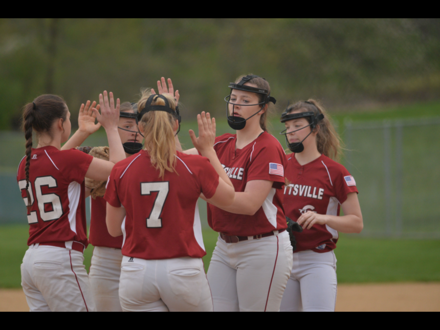 "The team meets up at the pitcher's mound slapping fives after a good play. "" I have been playing softball for eight years. My favorite position is pitching because that's where I feel the strongest and I can control the pace of the game,"" said freshman Alex Blum."