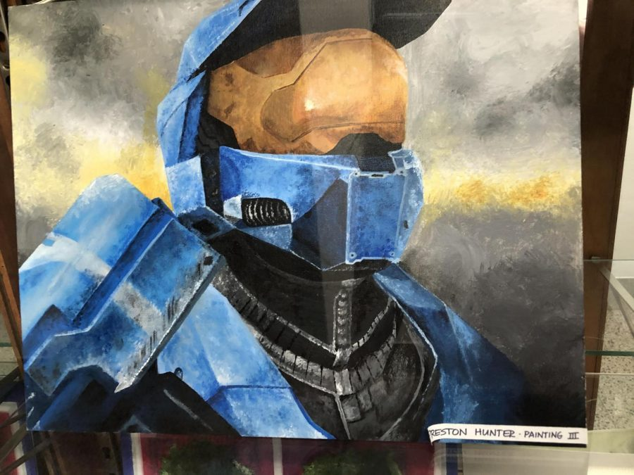 """Senior Preston Hunter submitted a painting of a Halo character for his Painting III class. """"I wanted to do what I like in every art piece, so I wanted to choose that game [Halo] to represent what I like to play. The hardest part was the detail in the mask of the character and making it look realistic. It took me about five hours of work to complete my painting."""