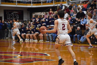"Senior Mason Barnes is  dribbling down the court scanning the floor for an open teammate. Barnes has been a varsity player since his freshman year. Barnes said, ""I never want this season to end but when it does, we will definitely embrace the time we had as a team."""
