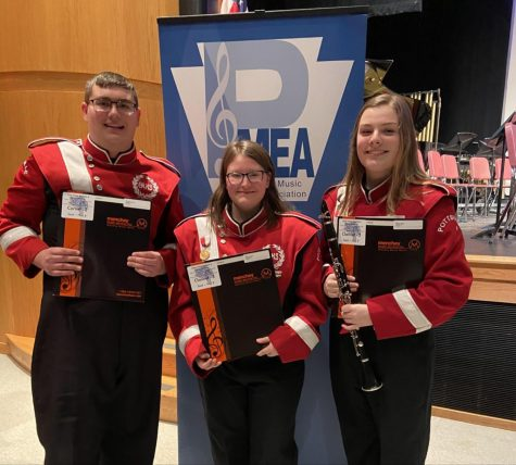 "(From Left to right) Christian Honicker, Grace Mongrain, and Vanessa Biddle stand in front of the P.M.E.A District Band Concert sign. All three students qualified to Regional Band after their successful efforts at District Band. Honicker said, ""I wasn't expecting to get this far. I guess it goes to show how far we have come as musicians."""