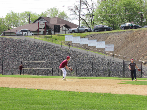 "John Holobetz stands on second base preparing to catch any oncoming balls. The first official practice for spring sports began on March 2, 2020. ""Being a senior, I try to be a supportive leader,"" said teammate senior Damon Yost pictured at right."