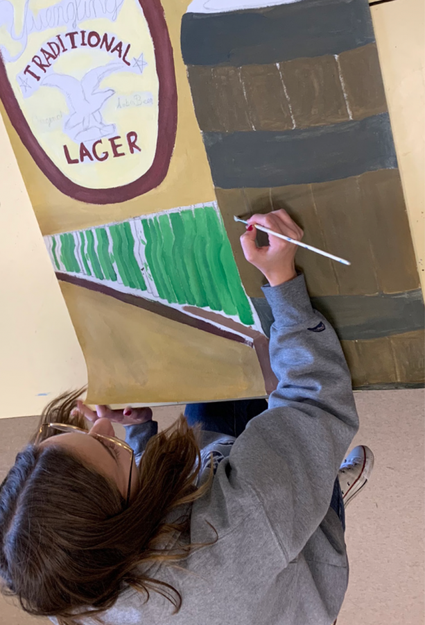 Senior+Shannon+Strickland+paints+her+part+of+the+Points+of+Light+Mural.+The+mural+is+a+collaborative+project+between+schools+across+Schuylkill+County.