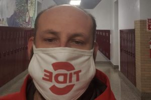 """Head Custodian, Mr. Brad Ross is wearing his C-Tide mask, while at work. Masks are mandatory because of the Coronavirus. """"My goal is to complete much needed repairs since we have extra time,"""" said Ross."""