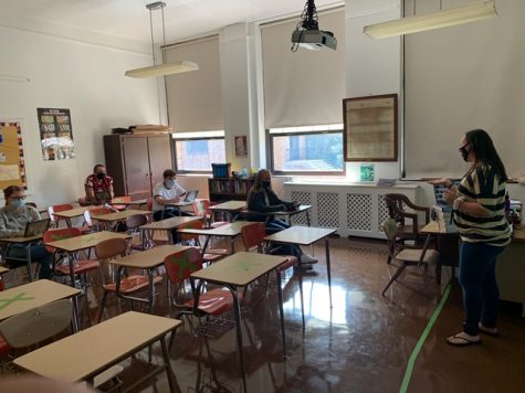 "Students sit inside Mrs. Watt's classroom socially distanced during class. A lot of schools had to adjust to a hybrid plan because of socially distancing guidelines. Sophomore Kenzie Androshick (not pictured) said, ""It overall just limited the things I could and couldn't do. 2020 was not the year we expected."""