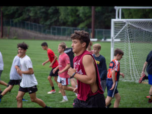 """Senior Nico Boris is running down the field during his soccer practice. The PIAA And Governor Tom Wolf agreed to let fall sports continue. """"I feel great that we are actually allowed to play. I would've been heartbroken if we weren't allowed. Coach  Reichert has been just making sure we are focused to try and cram everything in last minute because it is difficult to cram an entire off-season into one month."""""""