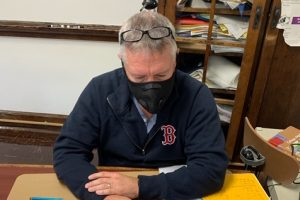 """Mr. Sterner is taking safety precautions by wearing his mask while teaching class. Masks were made a requirement in order to enter the building at Pottsville Area. Mr. Sterner said, """"I find it is much more difficult to get to know my students, only getting to see kids no more than 2 days a week and only seeing half of their faces while they are here."""""""